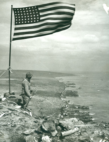 marine and flag, Mt. Suribachi, Iwo Jima