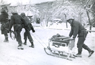 Soldiers with sled full of ammunition