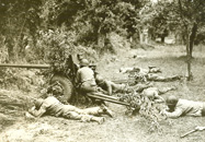 Anti-tank GIs lay low amid German shelling in Avranches, France