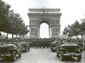 GIs parade through the Arc de Triumph in Paris