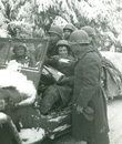 Back from the Ardennes, William Rush shares a Christmas present with his buddies