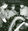 Patton observing engine maintenance in the Third Army