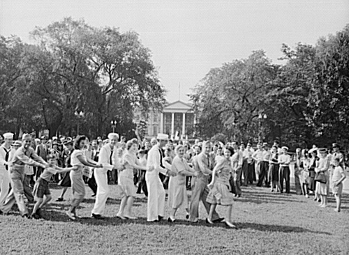 Washingtonians watch a conga line in Lafayette Square Park