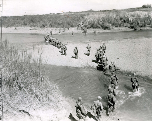 US 6h Army and Filipino guerrillas on the march