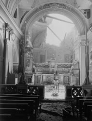 A GI standing in the bomb-damaged sanctuary of a church in Acerno, Italy, September 1943