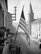 The Stars and Stripes appears over Bitche, France, March 16, 1945